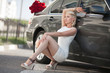 beautiful woman with flowers and luxury car outdoor