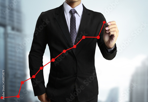 Business man hand drawing  graph