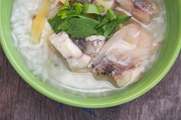 Rice Soup With sea bass fish (Thai food) on wood