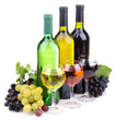 bottles and glasses of wine and assortment of grapes, isolated
