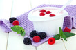 Delicious yogurt with berries on table close-up