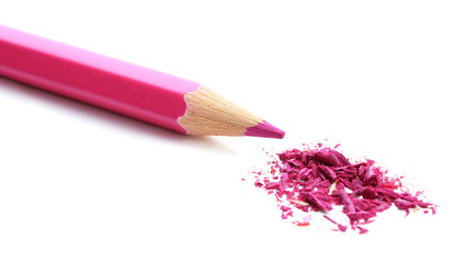Pink pencil with sharpening shavings isolated on white