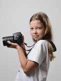 Preteen girl wth the slr camera