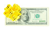 Dollar bills with yellow bow isolated on white