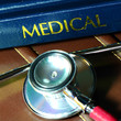 Stethoscope and medical text book on the doctor's desk.