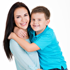 Happy smiling young mother with son