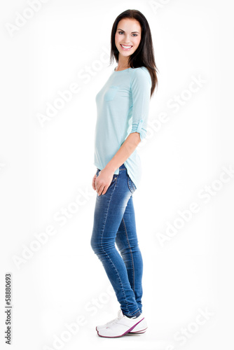 Full portrait of a beautiful young happy woman
