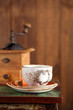 coffee cup with Nostalgic coffee grinder on background