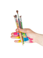 Paintbrushes in hand