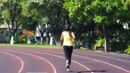 A young woman exercising in a stadium