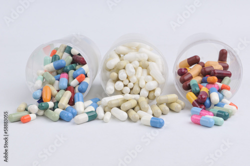 assortment of pills, capsules and tablets variety in plastic pot