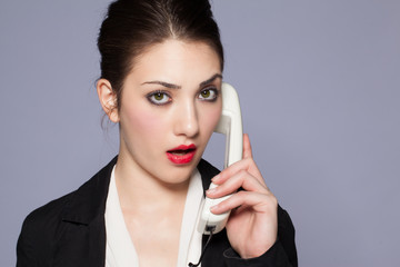beautiful girl at the phone has a puzzled expression