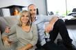 Happy senior couple enjoying glass of champagne