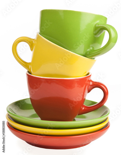 stack of multicolored tea cups and saucers