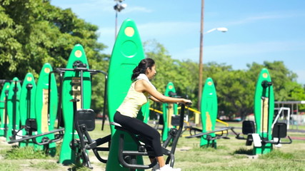 A young woman using an Exercise machine