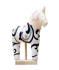 Hand made soft toy horse isolated on white with pink on the stan