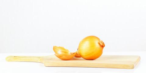 Fresh raw onion on a cutting board closeup