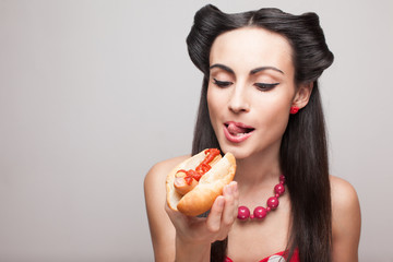 pinup styled girl wants to eat hot dog
