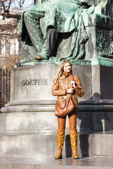 woman standing by Johann Wolfgang Goethe''s statue, Vienna, Aust