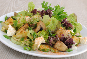 Salad with mushrooms with zucchini, cheese in lettuce leaves and