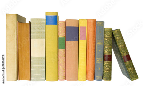 row of vintage books isolated on white background