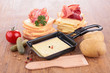 raclette on wood background