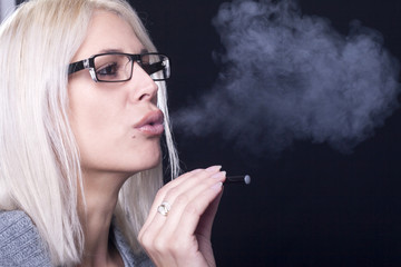 Young woman Smokin Electic Cigarette