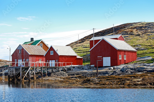 Traditional Norwegian coastal village with red wooden houses