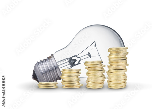 Light bulb and coins. Isolated on white background