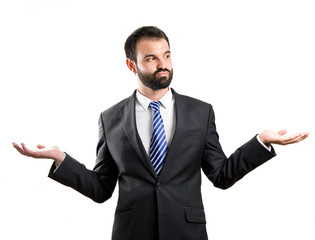 Businessman making a balance gesture over white background