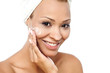 Pretty woman applying face cream