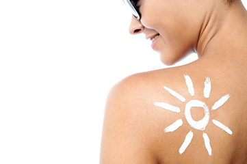 Woman with sun block cream on her back