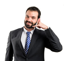 Young businessman talking over white background