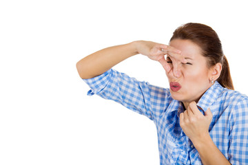 Woman covers her nose, can't breath, something stinks