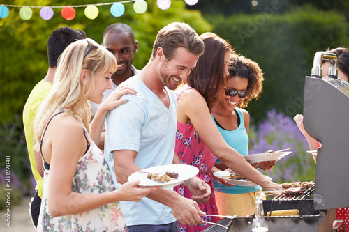 Group Of Friends Having Outdoor Barbeque At Home - 58892840