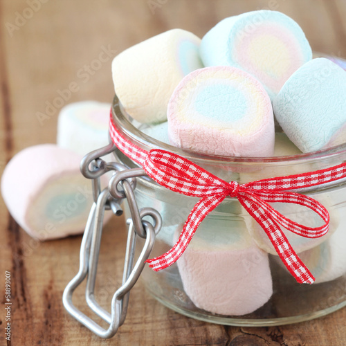 Marshmallows in a glass jar decorated with a bow