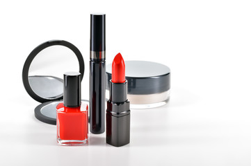 Basic red makeup cosmetics on white background.