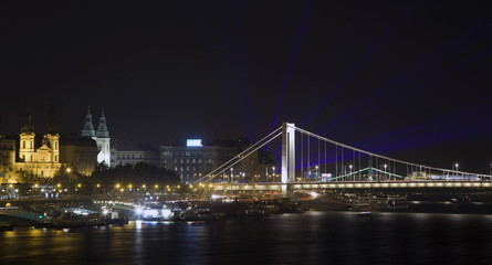 Elizabeth bridge with laser rays on the evening sky in Budapest,