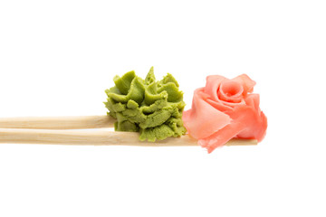 Ginger and wasabi on chopsticks isolated on white background