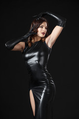 Dancing model dressed in clothes from latex. BDSM. Fetish.