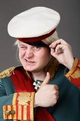 Actor dressed as Russian Generalissimo Suvorov, showing OK sign