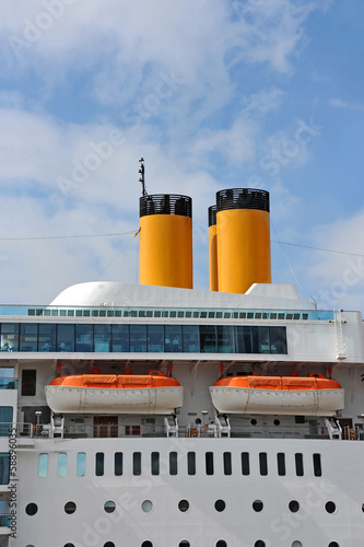 Safety lifeboat and chimney of a cruise ship