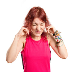 Young girl covering her ears over white background