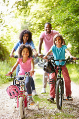 African American Family On Cycle Ride In Countryside