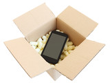 Shipping box with black smartphone, isolated on white