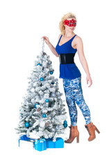 Young woman and New Year's tree