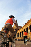 Cycling tourists around the Plaza de España, Seville
