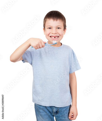 Boy portrait with toothbrush and lost tooth