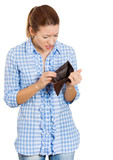 Sad, stressed woman holding empty wallet
