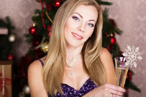Pretty woman wearing dress with glass of champaine